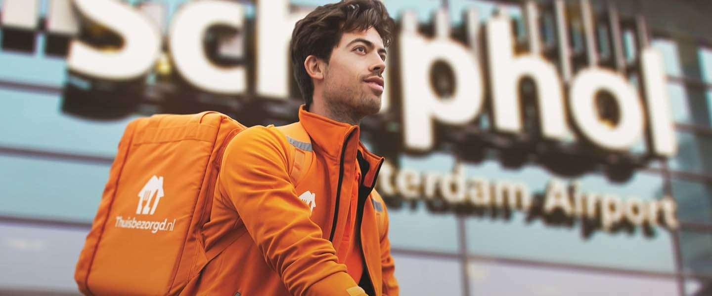 Thuisbezorgd gaat ook bij bedrijven op Schiphol bezorgen
